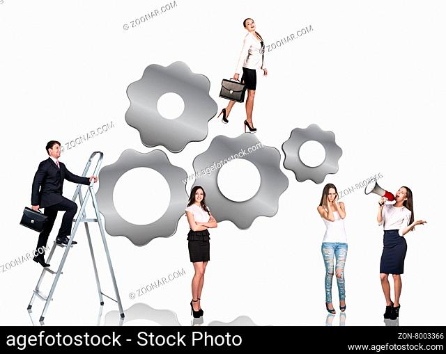 Businessman climbs up on the stepladder and women stands beside isolated on the white background