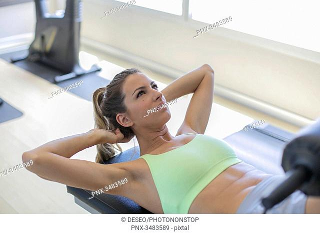 Woman doing crunches in fitness center