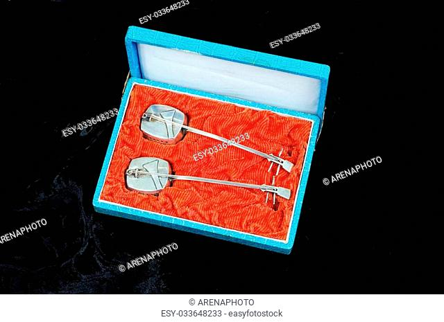 Two sterling silver guitar shaped incense holders in a blue and red case
