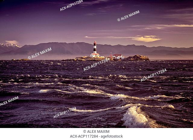 Race Rocks Lighthouse beautiful dramatic sunset scenery. The second oldest lighthouse on Canada's west coast. Victoria, Vancouver Island, BC, Canada 2017
