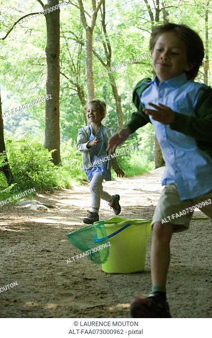 Children running in woods