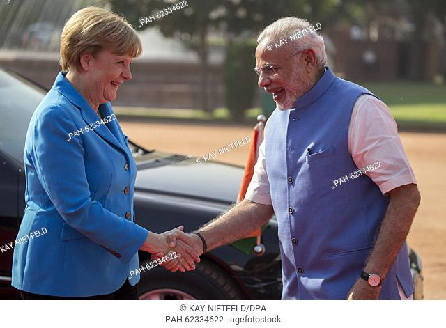 German Chancellor Angela Merkel (L) is greeted by Indian Prime Minister Narendra Modi (R) on her arrival in New Dehli, India, 05 October 2015