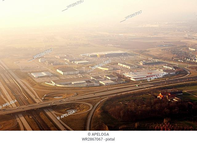Aerial view of industry amidst landscape in foggy weather