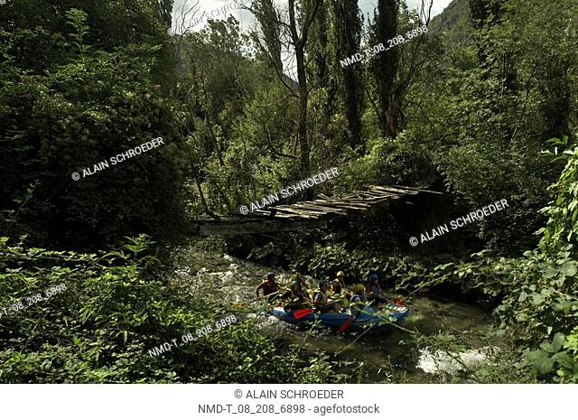 High angle view of a group of people rafting in a river, Nera River, Valnerina Valley, Umbria, Italy