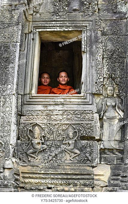 Buddhist monks in the inner part of Bayon temple,Angkor Thom, Cambodia,South Esat Asia