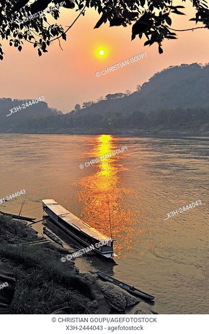 sunset on Mekong River at Luang Prabang, Laos, Southeast Asia