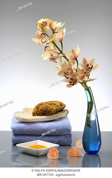 Orchid with towel, sponge, massage gloves and bath salt