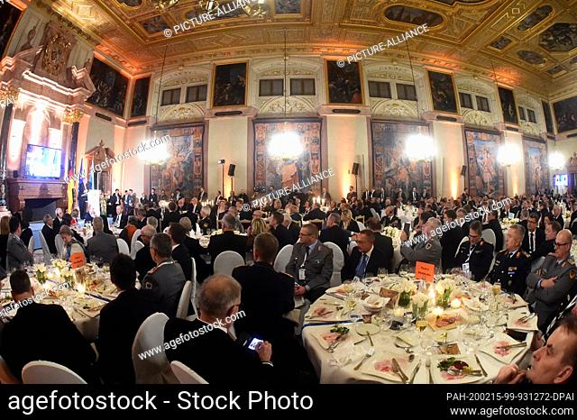 15 February 2020, Bavaria, Munich: Participants of the Munich Security Conference sit at the traditional dinner in the Kaisersaal of the Munich Residence
