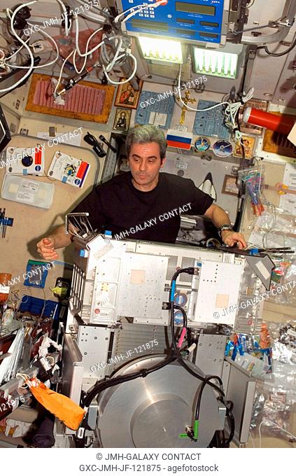 European Space Agency (ESA) astronaut Leopold Eyharts, Expedition 16 flight engineer, works with the Treadmill Vibration Isolation System (TVIS) removed from...