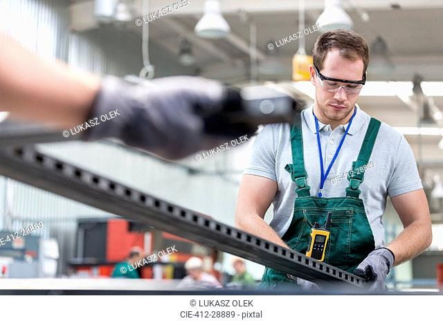 Worker in protective workwear in factory