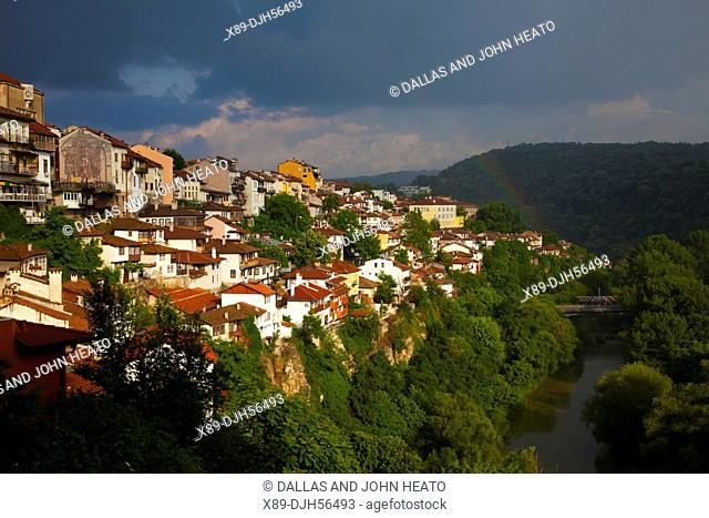 Bulgaria, Europe, Veliko Tarnovo, Hillside Houses towering above the Yantra River, Stormy weather at Dusk