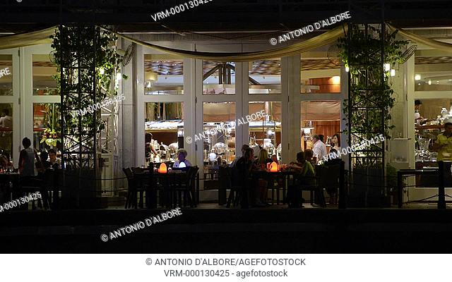 People dining at a luxury outdoor restaurant. Singapore