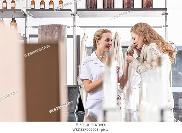 Client smelling at sachet in wellness shop