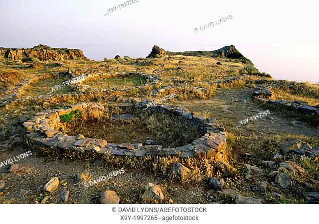 Prehistoric 3400 years old Bronze Age village hut circles on the promontory of Capo Milazzese. Aoelian Island of Panarea, Italy