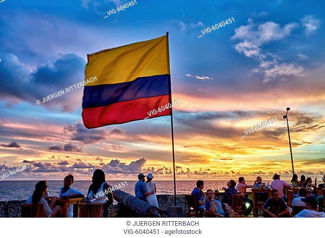 Colombian flag at sunset at Cafe del Mar, Cartagena de Indias, Colombia, South America - Cartagena de Indias, Colombia, 30/08/2017