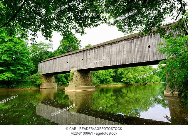 A lazy summer day for an old wooden covered bridge, Pennsylvania, USA