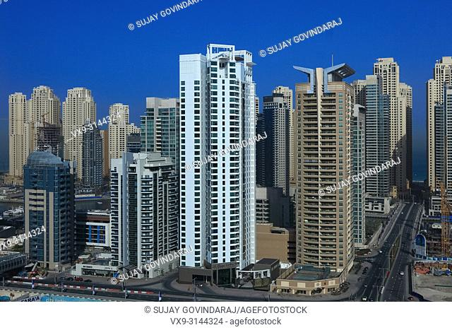 Dubai, UAE - March 19, 2009: High angle view of the Towers on Dubai Marina. Construction continues even though the rest of the work is in an economic crisis
