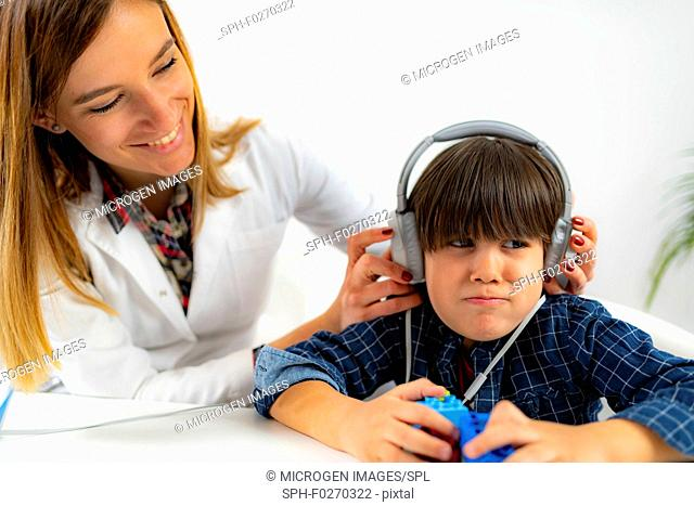 Boy having a hearing test in an audiologist's office