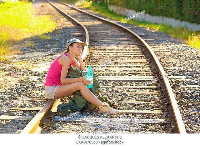 Woman sitting on track