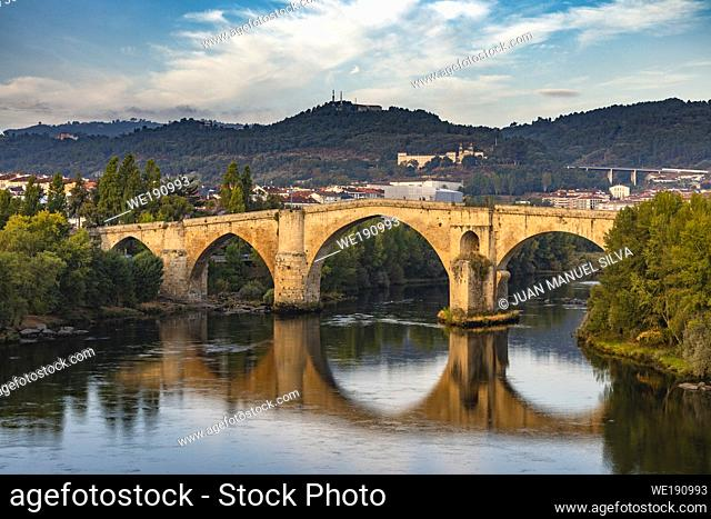 Roman bridge in Ourense (Galicia, Spain), over river Miño and city scape in the background