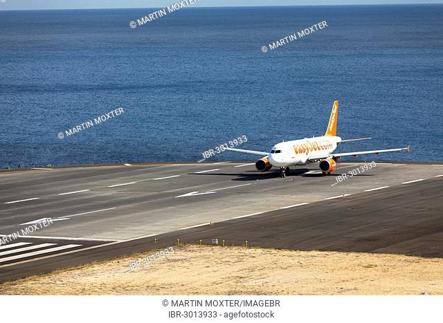 Airbus from easyjet.com preparing for takeoff at Madeira Airport, LPMA, also known as Funchal Airport and Santa Catarina Airport