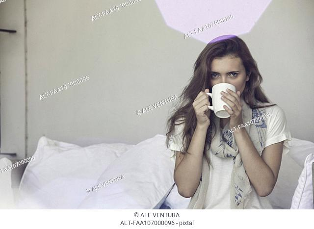 Woman drinking cup of tea