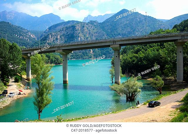 Catalunya, Spain, La Baells dam at the Torrent de la Garriga near Cercs village municipality of Bergueda. C-16/E9 Viaduct crossing the image
