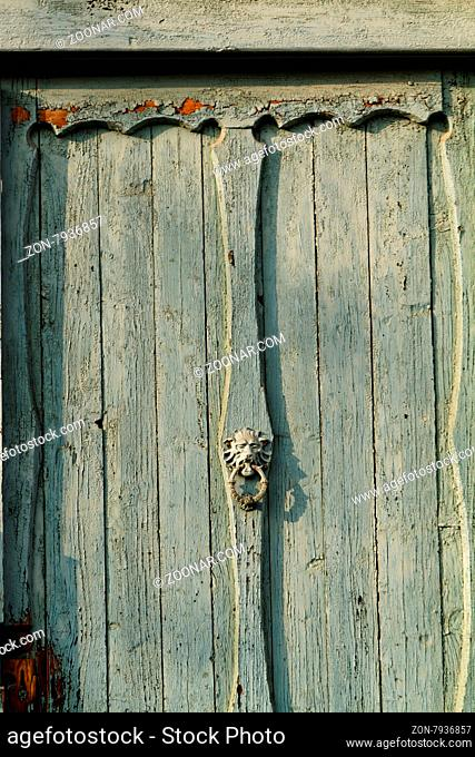 Photo of a grey wood and old gate