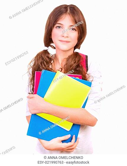 Cute schoolgirl with colorful books