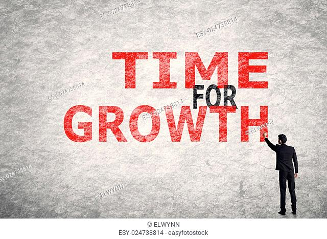Asian businessman write text on wall, Time For Growth