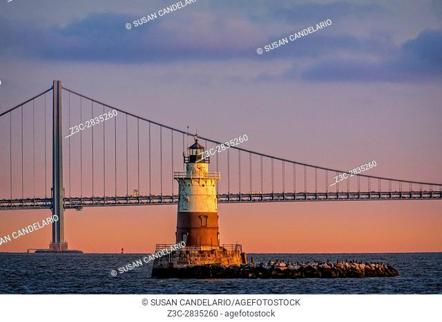 Robbins Reef Light and Verrazano Narrows Bridge - The Robbins Reef Light Station lighthouse located off Constable Hook in Bayonne and along the west side of...