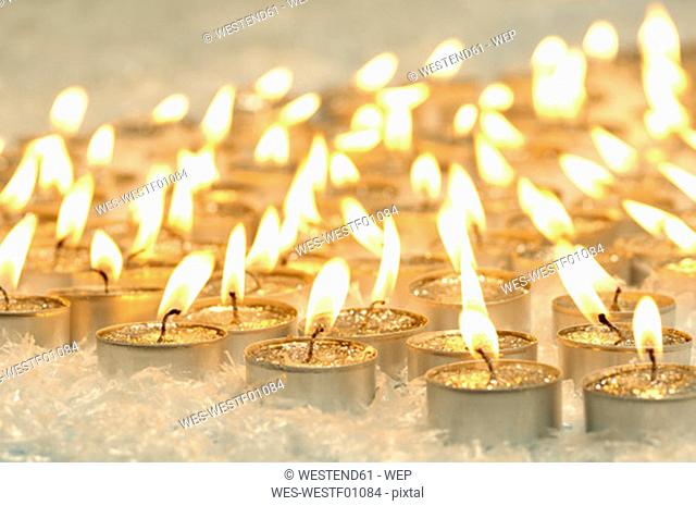 Burning tea lights, Christmas decoration