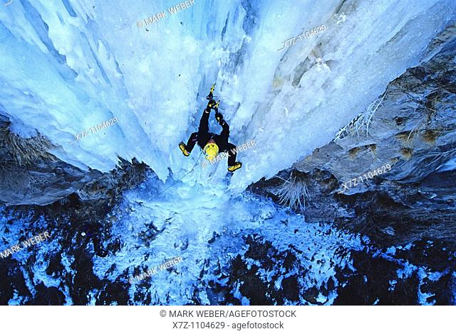Man, ice climbing a route called Neutron at the Mother Lode Area in the Snake River Canyon near the city of Twin Falls, Idaho