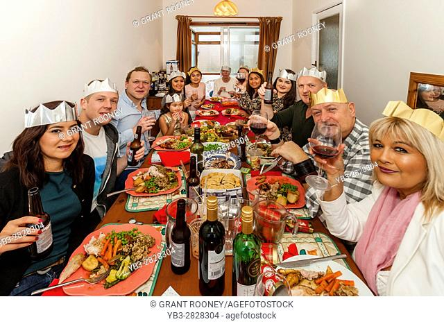 A Multi Ethnic Family Sit Down To A Traditional Christmas Lunch, Sussex, UK