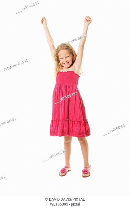 A beautiful excited Caucasian girl on a white background