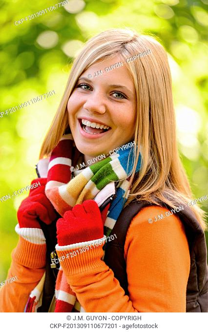 Autumn happy girl fall smiling teenager colorful scarf