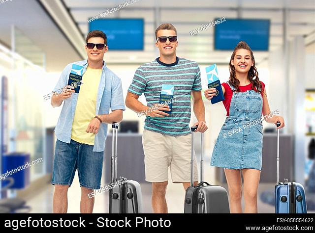 happy people with tickets and immunity passports