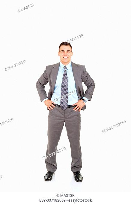 Rear view of business man hands in pockets isolated over white background, full length portrait,looking at camera