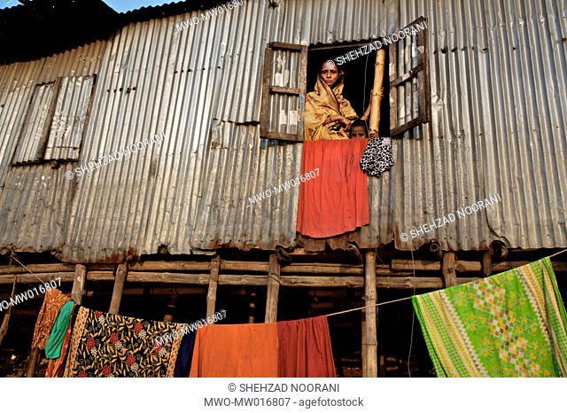 Woman in Gazi Osman Pasa poor area of Istanbul 2006, Stock