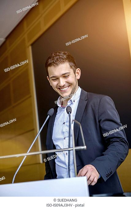 Young businessman speaking in conference meeting