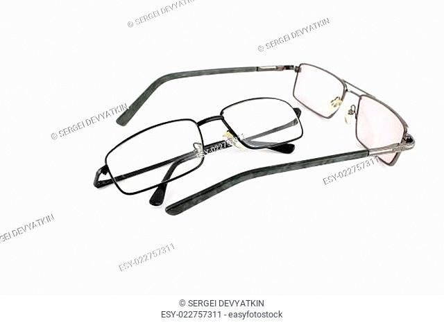 Two optical glasses over white