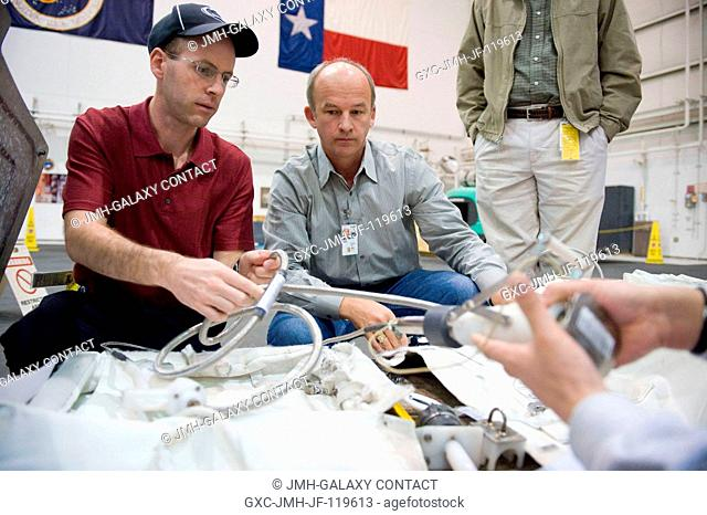 Astronaut Jeffrey Williams (center), Expedition 21 flight engineer and Expedition 22 commander, participates in a 1-G extravehicular activity (EVA) training...
