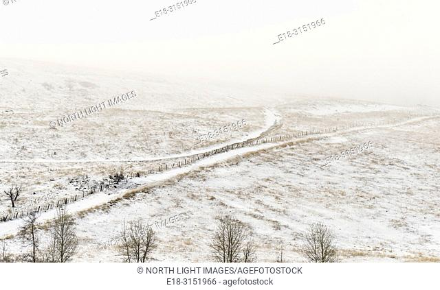 Canada, BC, Bridesville. Farm roads running through cold, snowy fields