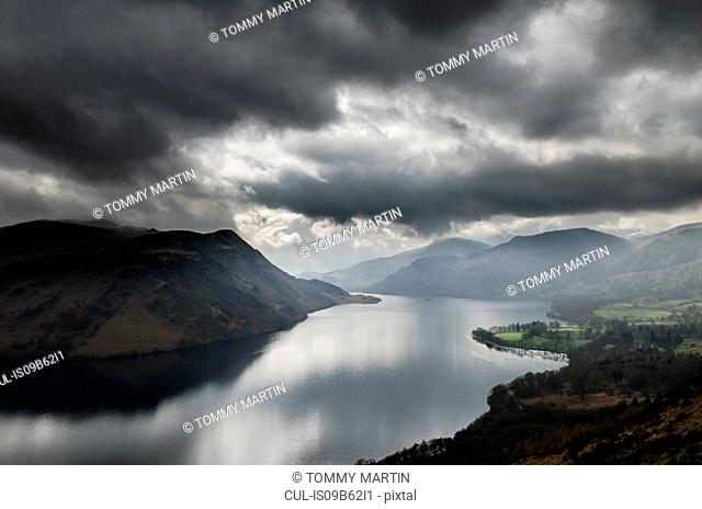 Storm clouds over Ullswater lake, seen from Gowbarrow Fell, The Lake District, UK