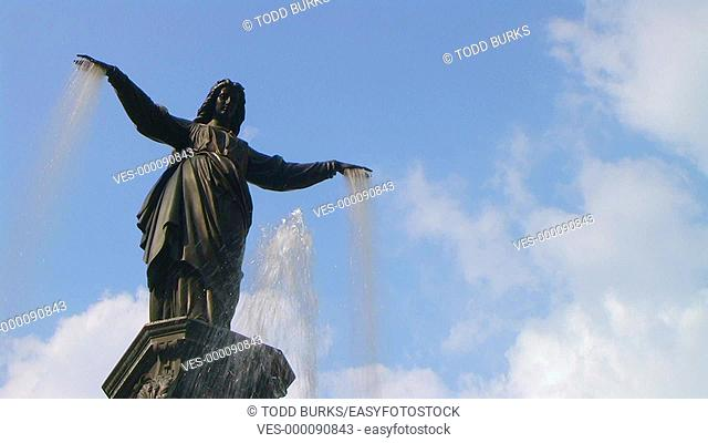 Female statue fountain with water flowing from hands