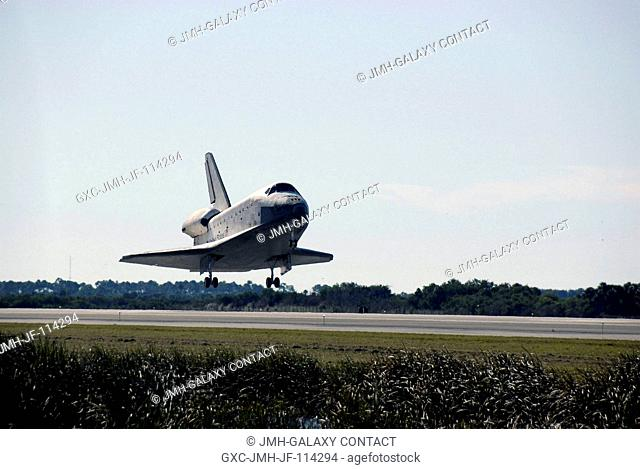 Space shuttle Atlantis approaches landing Runway 33 of the Shuttle Landing Facility at NASA's Kennedy Space Center, concluding 11 days in space and completing...