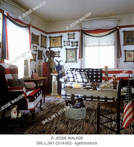 LIVING ROOM - American theme, patriotic red white and blue upholstered sofa and wing chair, swag red white and blue fabric on windows, lace curtains