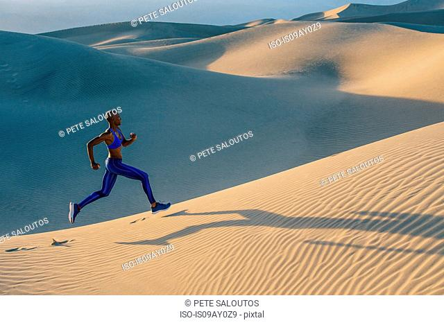 Runner sprinting in desert, Death Valley, California, USA