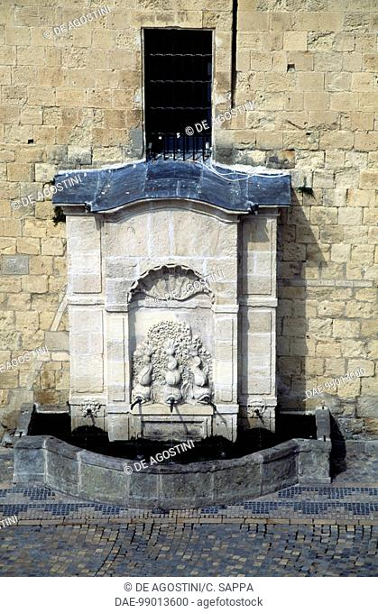 Stone fountain at the base of Gilles Aycelin dungeon, 1290-1311, Place de l'Hotel de Ville, Narbonne, Languedoc-Roussillon, France