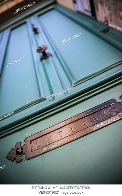 Mailbox slot in a old door, Albi (Tarn Department, Occitanie Region, France)